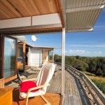 West End Beach House - living and deck
